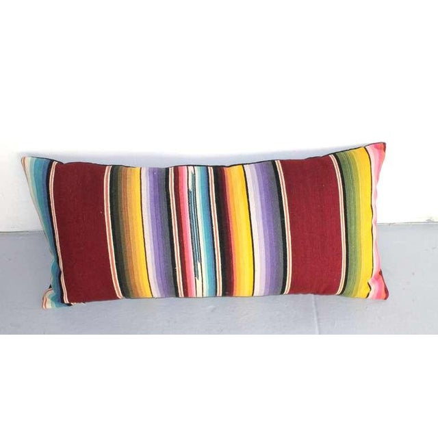 This colorful handwoven Mexican serape is a bolster size great on a bed or sofa. The back is in black cotton linen. The...