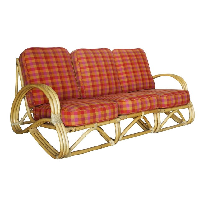 """Three-strand """"S-arm"""" rattan living room set which includes one lounge chair and a matching three-seat sofa. Each seat..."""