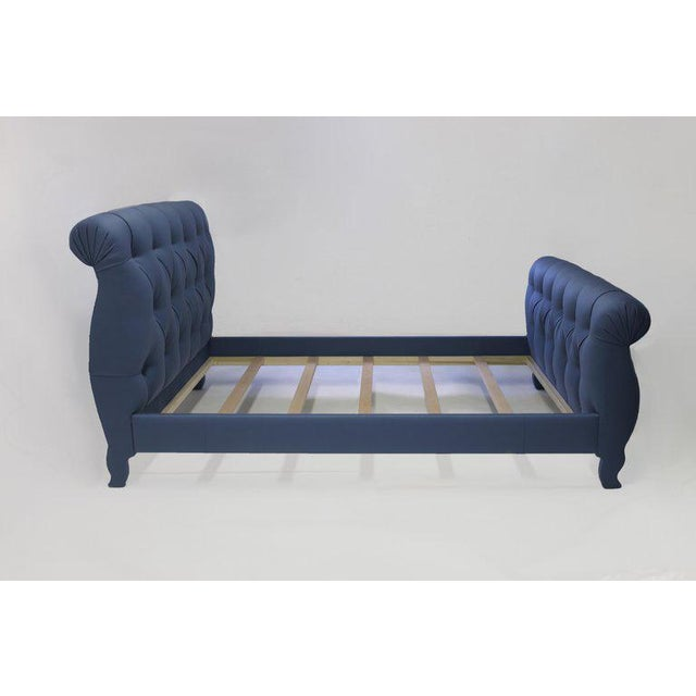The dreamy Dover bed shown in blue fabric with tufting and self covered buttons in tufts - all handstitched and crafted...