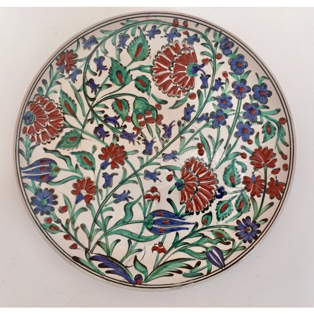 A decorative I Karos Pottery, I Caro collector set of two polychrome hand-painted and handcrafted in Rhodes, Greece...