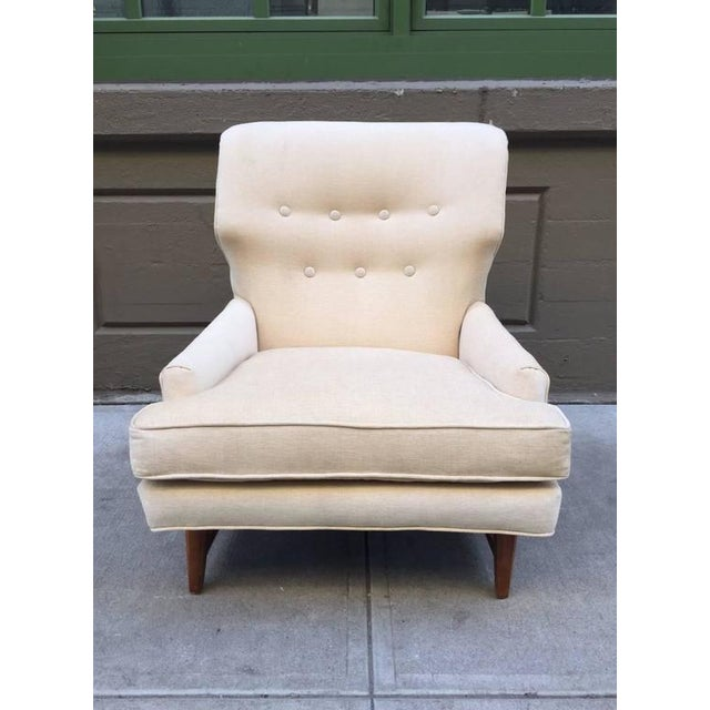 Lounge chair by Edward Wormley for Dunbar. Has a walnut base and newly upholstered.