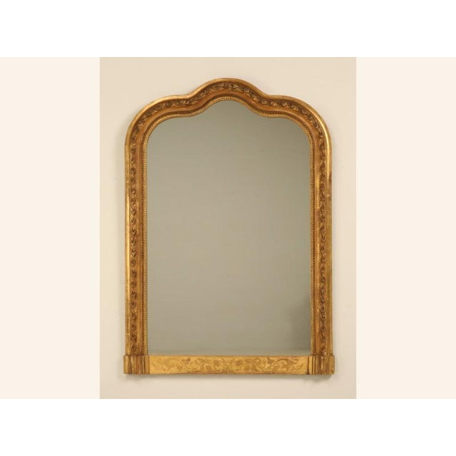 Extremely unusual shape for a French antique mirror and especially so since it still retains its original water gilded...