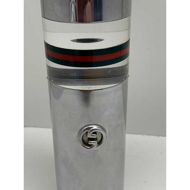 A vintage 1970s Gucci Italian table lighter in Lucite acrylic and metal chrome. It is signed Gucci on the base and has a...