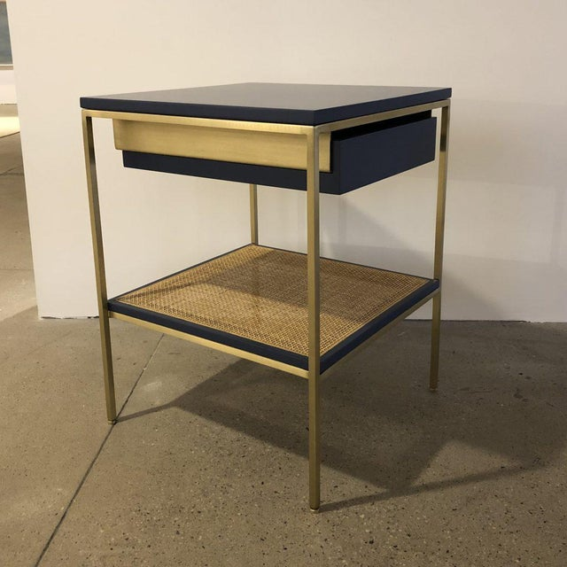 re: 392 lacquer and brass bedside tables. Available in custom colors for a 10% up-charge. Solid or caned shelf options....
