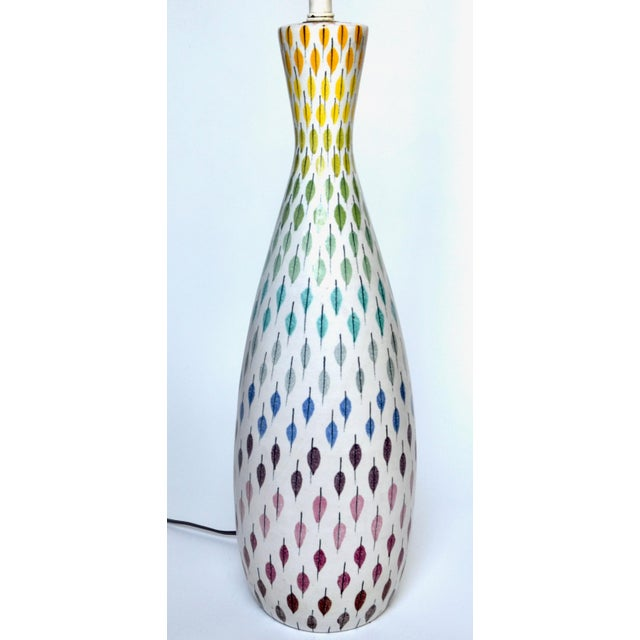 A lovely large Italian ceramic lamp by Aldo Londi for Bitossi with multi-color pastel feathers. Original 1950s lamp,...