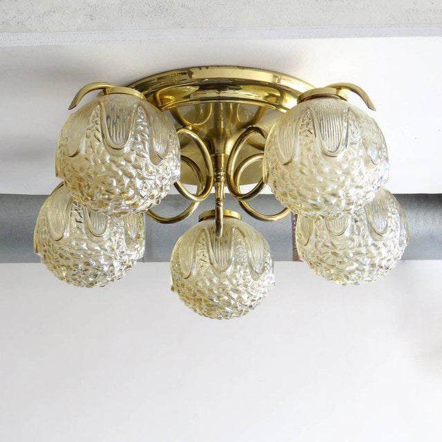 Wonderful German five-globe glass and brass flush mount fixture with amber colored glass with a pronounced geometric...