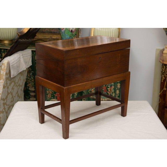 This is a traditional mahogany English mahogany with lap desk with satinwood banding, opening to reveal inkwells, interior...