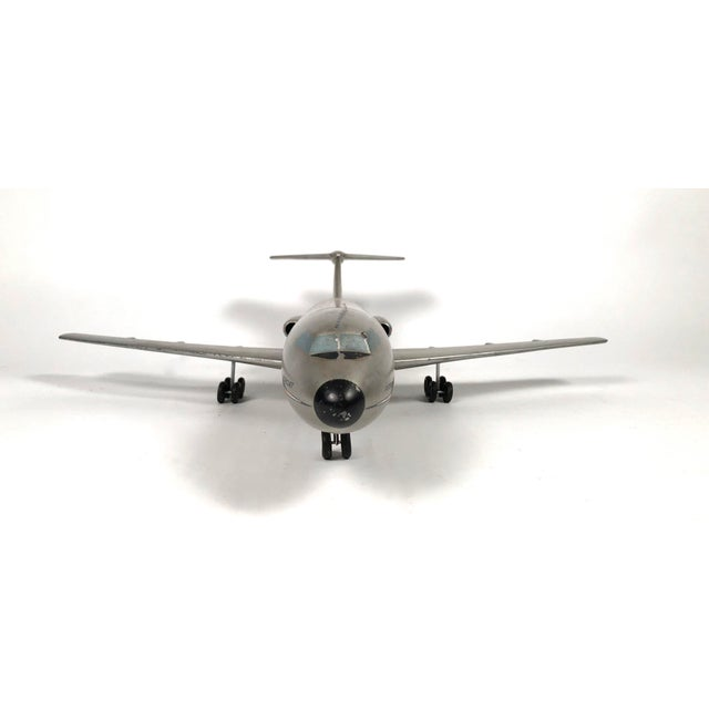 A vintage American Airlines Astrojet aviation model, circa 1950-1960s, in silver painted metal with aircraft livery in...