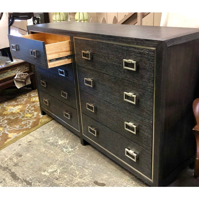 Very sophisticated 8 drawer dresser with silver mist finished accent handles. The stainless steel frame around each bank...