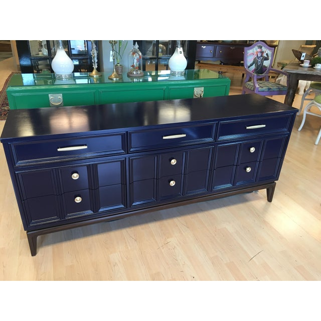 Made by The Dixie furniture company 1960s, This Mid Century style dresser has been modernized in a in a deep navy blue hue...
