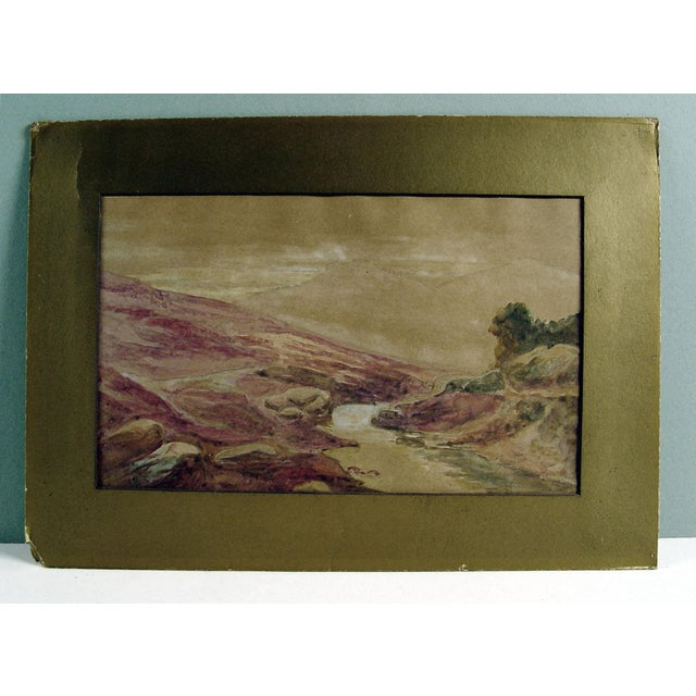Landscape watercolor on paper, circa 1900. Unsigned. Unframed, displayed with original gold mat. Paper if attached to...