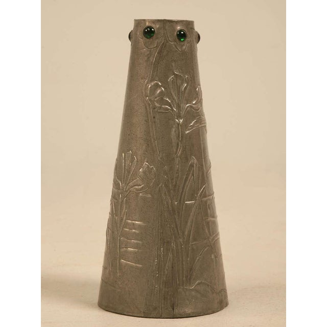 French art nouveau metal vase. Signed Lola 1911. The top is embellished with green glass cabochons and the body is...