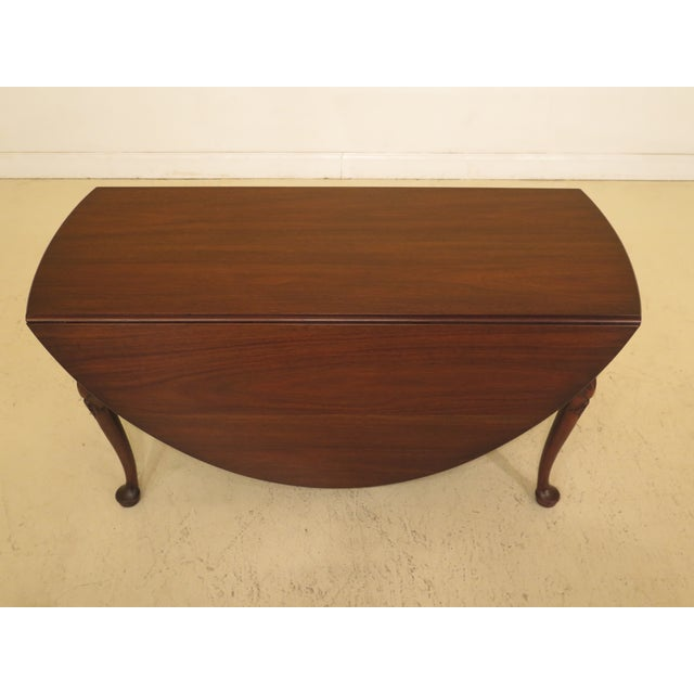 Kittinger Colonial Williamsburg mahogany drop leaf table CW-117. Features mahogany fine carved details, high quality...