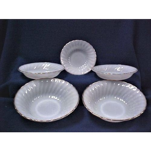 Set of 5 Fire King Bowls These bowls are made by Anchor Hocking. They are white milk glass color with a swirl pattern and...