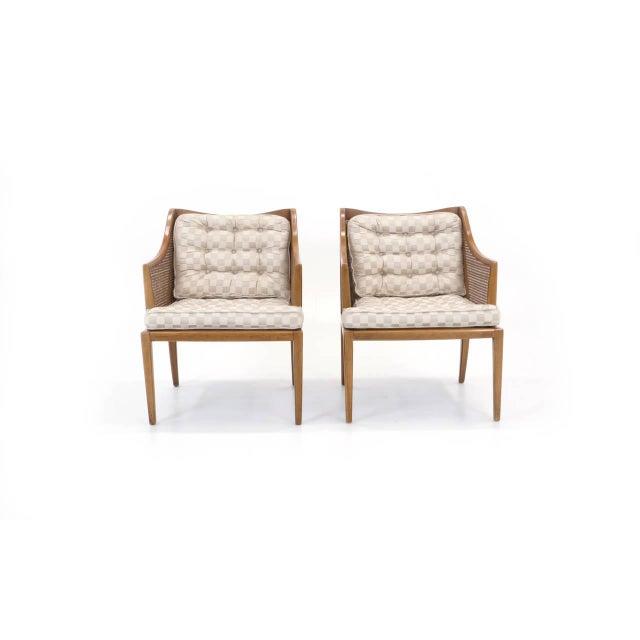 Elegant pair of Robsjohn-Gibbings armchairs.