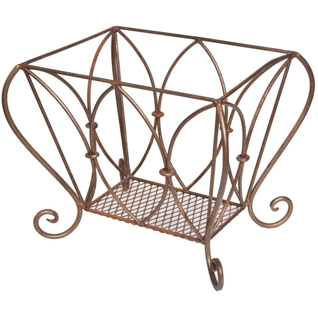 Stunning handmade wrought iron magazine/wood bin in lovely aged bronze finish accented in gold tones.
