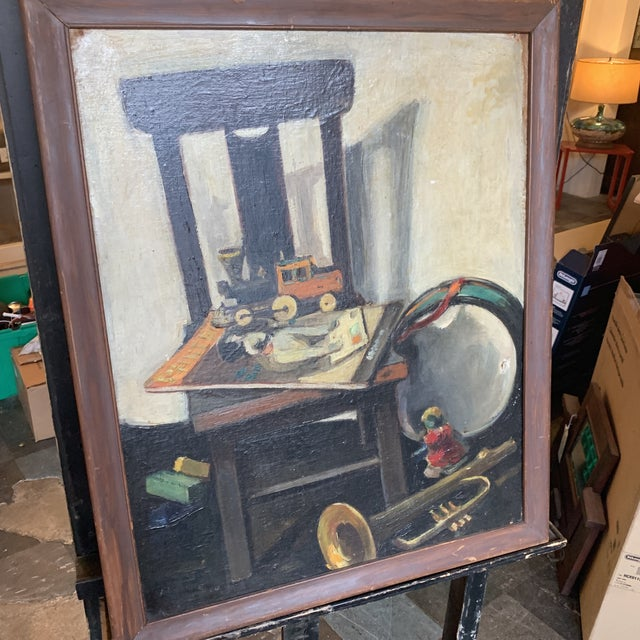 This is a mid century still life with toys unsigned oil on board.