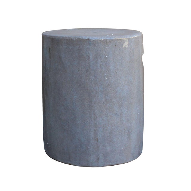 This is a handmade Chinese accent decorative garden clay stool in a round flat column shape. The surface is glazed with...