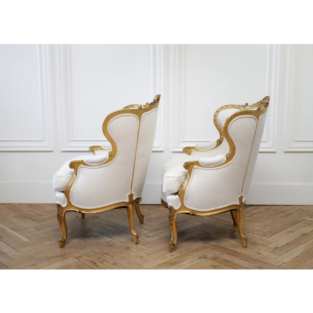 Pair of Antique Giltwood Linen Upholstered Bergère Chairs SKU Number: 7772-0112812 Description: Pair of antique giltwood...