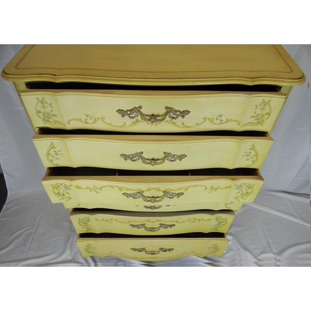 This is a lovely tall French Provincial style dresser with soft blue, green and yellow hand-painted flowers and details....