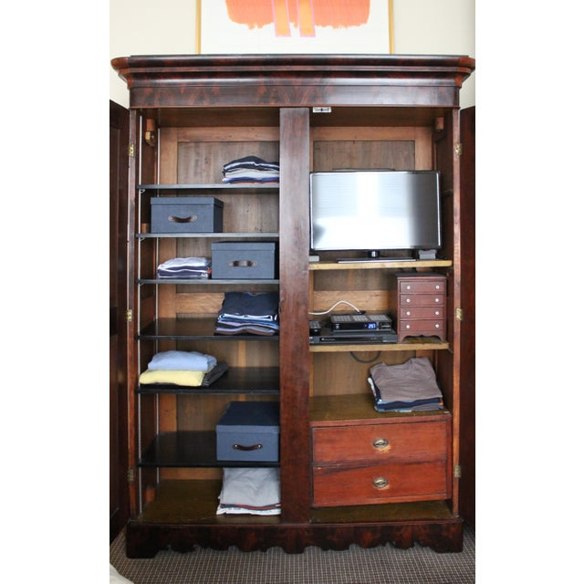 Purchased from a dealer in Pennsylvania, this 1840's English armoire is a practical storage solution made of French...