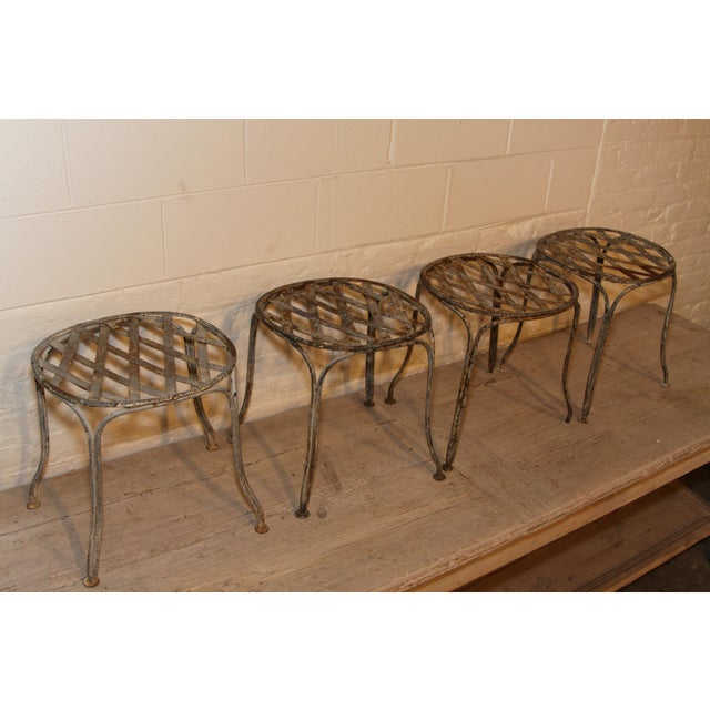The most charming set of four century garden stools from the 1920s, discovered in the markets of Paris.