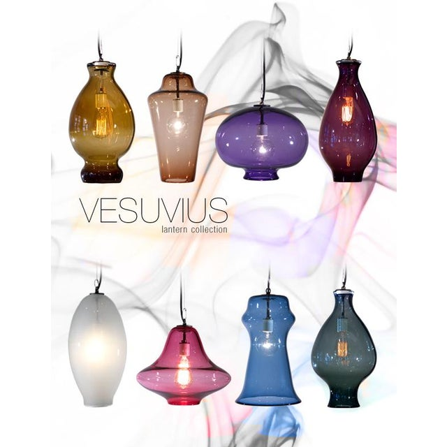 This purple pendant imparts a glamorous radiance to your surroundings. Made from luxurious hand-blown glass, choose from a...