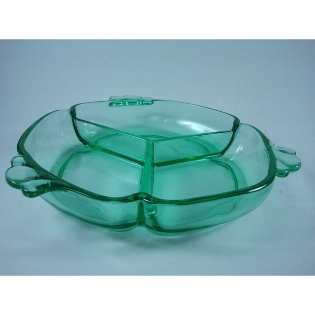 A beautiful three-part relish dish from the renowned Heisey Glass Company in the hard-to-find Moon Gleam color. The piece...