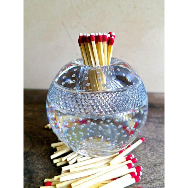 A vintage Thomas Webb blown crystal match striker. This spherical piece has a bubbled interior, while offering a match...
