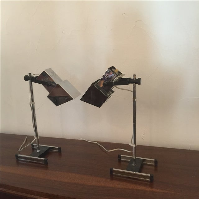 Pair of Mid century Modern architectural chrome desk lamps. It has a walnut inlay at the base of the lamp. Head height is...