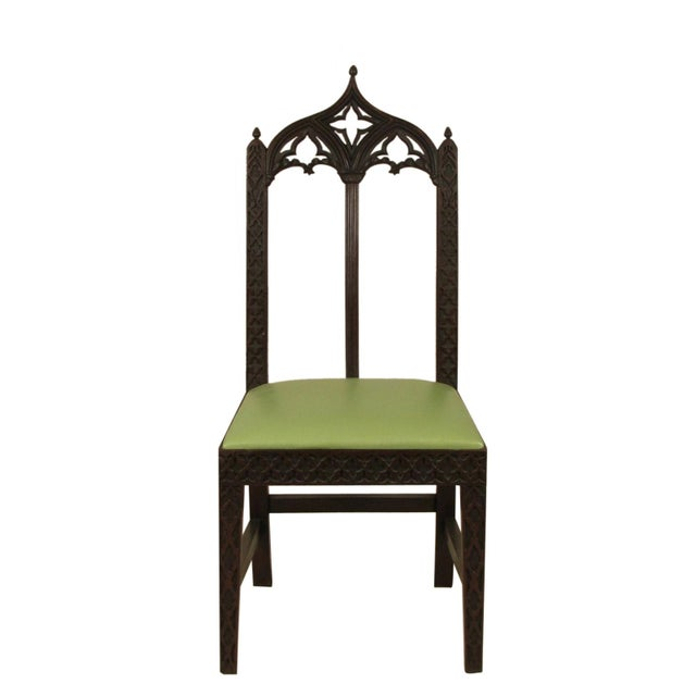 A set of eight 19th-C. English Gothic mahogany side chairs with outstanding hand carved details and new custom Edelman...