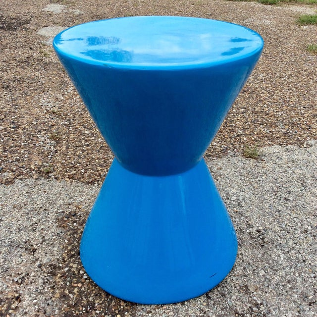 Mid century blue molded fiberglass modernist corseted side table. We always accept reasonable offers.