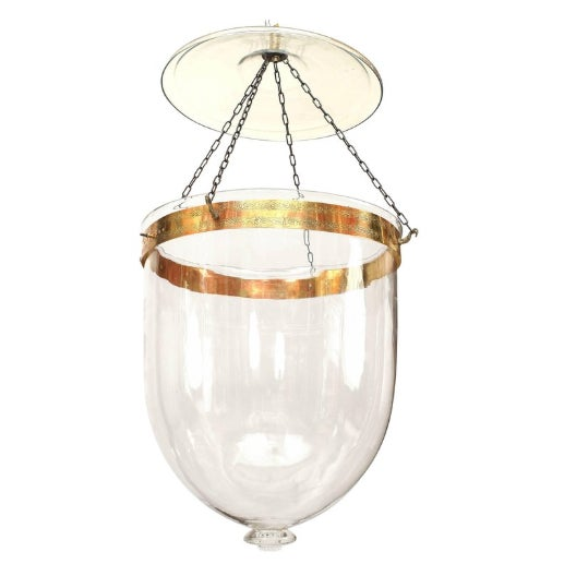 English Georgian style clear glass hanging lantern suspended by chains from a glass cover and brass ring with etched design.