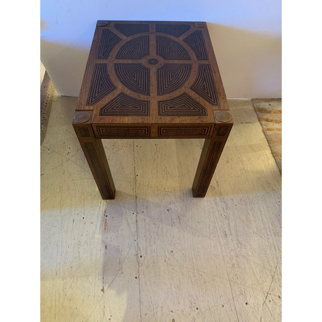 Handsome rectangular inlaid wood end table having stunning geometric design and brass medallions in each corner on top of...