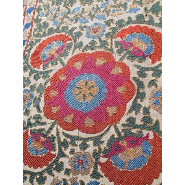 Central Asian embroideries, known as Suzanis, are renowned for their dynamic and organic drawing and vivid natural color....