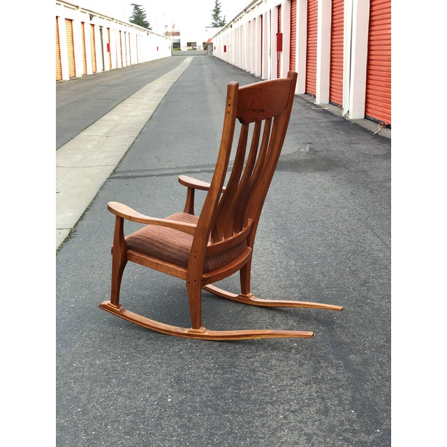 Gorgeously crafter rocking chair constructed with solid and laminated cherry and walnut. Architecturally sculpted with and...