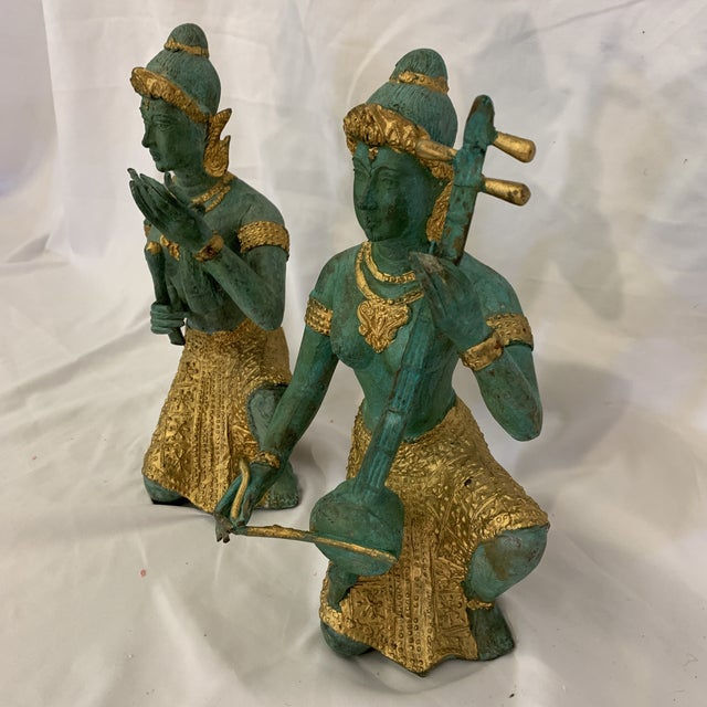 Really beautiful patina to these bronze Thai musician statues. Nice heavy weight and beautiful gold accents. The blue...