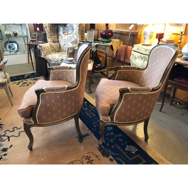 Wonderful pair of turn of the century Louis XV style walnut Bergere Chairs. Solid and sound with upholstery in great...