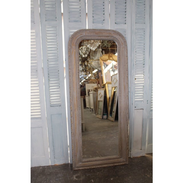 Vintage French Louis Philippe style mirror. Giltwood frame is newly refinished with a white wash and distressed to show...