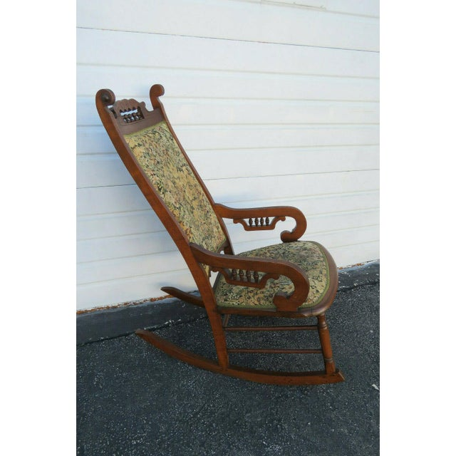 This brilliant Victorian rocking chair is made of wood, solid wood, and fabric, and is in good condition. This beautiful...