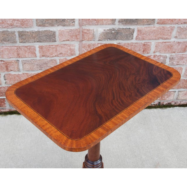 Custom designed English mahogany rectangular wine table with satinwood banding on top as well as on legs. Also available...