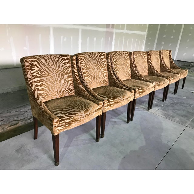 Set of six 1940s vintage dining chairs attributed to Dunbar covered in a deep gold animal pattern cut velvet, in very good...