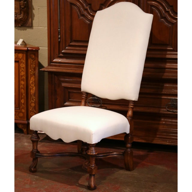 This set of ten walnut dining room chairs would make a sophisticated addition to any dining room. Crafted in France, the...