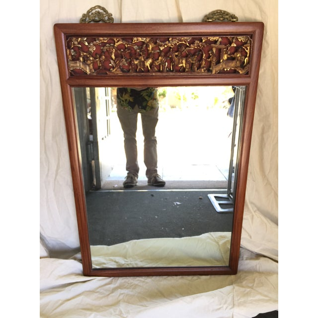 Highly carved Chinese mirror, made in Hong Kong, circa 1970, Solid teak, finished on the back as well, heavy brass hook to...