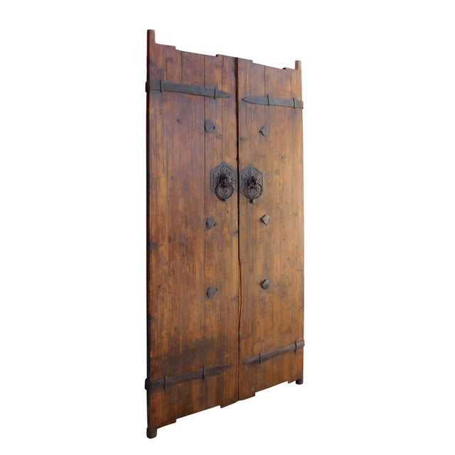 This is an old Chinese house door gate with iron hardware as accent. It has been restored on the surface with nice wood...