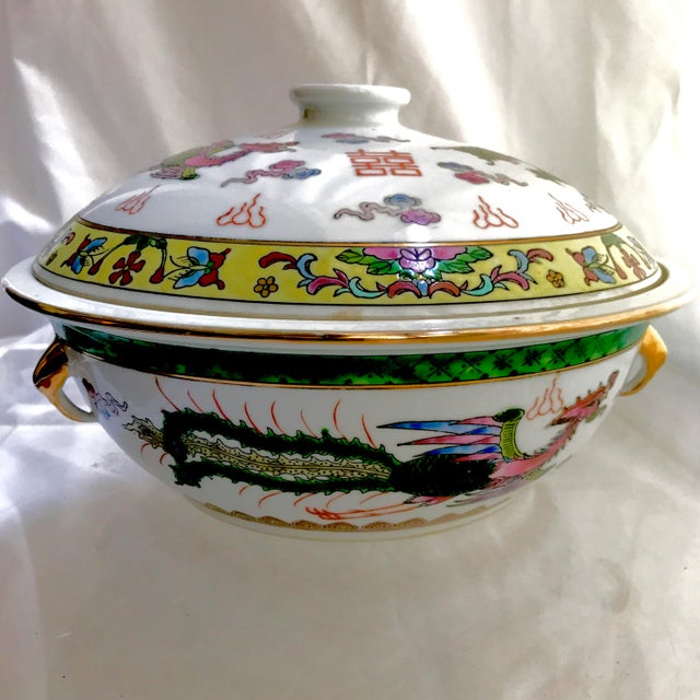 This stunning hand painted soup lidded Tureen with the dragon and phoenix painted around a lotus is as beautiful as it is...