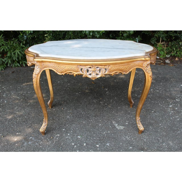 Louis XVI side or coffee table with Carrara marble insert. This table is made of solid oak and has been newly refinished...