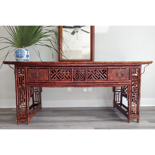 Antique Shanxi Provence Altar table in original red lacquer bamboo with black lacquer top. A striking piece of functional...