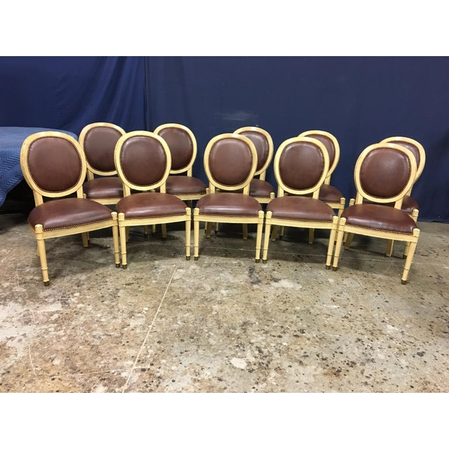 This is a set of ten Baker Oval Back Side Chairs. * Cream/yellowish color with mild distressing * Chocolate/brown leather...