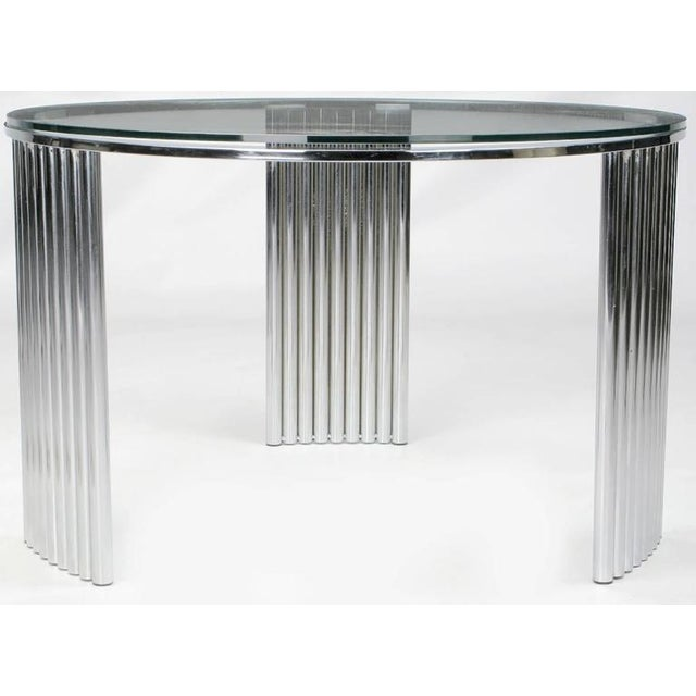 27 welded and chromed tubes form the three radius supports for this deco-Futurist coffee table, which would also work well...